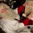 Santa Claus  writing on old paper roll — Foto Stock