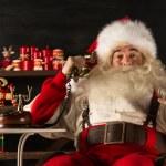 Santa Claus calling phone at home — Stock Photo #33882205