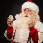 Santa Claus holding snow globe — Stock Photo #33882297