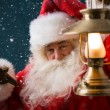 Santa Claus is holding a lantern — Stock Photo