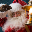 Santa Claus is holding a lantern — Stockfoto