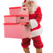 Santa Claus carrying stack of giftboxes — Stock Photo