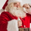 SantClaus drinking milk — Stock Photo #34274123