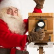 Santa Claus taking picture — Stock Photo