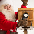 Santa Claus taking picture — Stock Photo #34274195