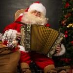Santa Claus sitting in armchair — Stock Photo #34274305