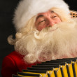Santa Claus sitting in armchair — Stock Photo #34274433
