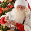 Santa Claus sitting in rocking chair  — Stockfoto