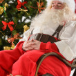 Santa Claus sitting in rocking chair  — Photo