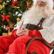 Santa Claus sitting in rocking chair  — Stock Photo