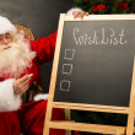 Santa Claus sitting near chalkboard — Stock Photo #34275559