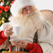 Santa Claus sitting in rocking chair  — Foto Stock