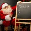 Santa Claus near chalkboard — Foto Stock