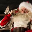 Santa Claus calling by phone — Stock Photo #34276115