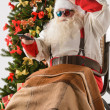 Santa Claus watching tv — Stock Photo