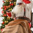 Постер, плакат: Santa Claus watching tv
