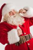 Santa Claus drinking milk  — Stock Photo
