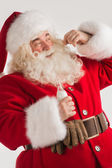 Santa Claus drinking milk — Stock Photo
