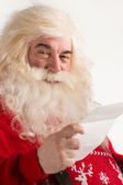 Santa Claus holding Christmas letter — Stock Photo
