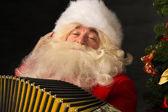 Santa Claus sitting in armchair  — Stock Photo