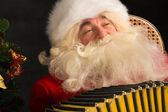 Santa Claus sitting in armchair — Stock Photo