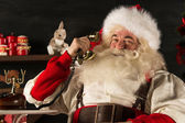 Santa Claus calling by phone — Stockfoto