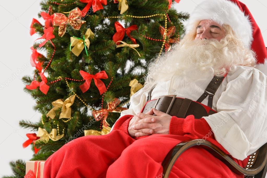 Babbo Natale Seduto Nella Sedia A Dondolo Foto Stock