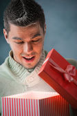 Man opening big gift box — Stock Photo