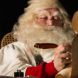 Santa Claus writing to do list — Stock Photo