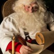 Santa Claus sitting at home and writing to do list — Stock Photo #35156603