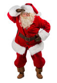 Santa Claus standing and peering far away — Stock Photo