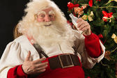 Santa Claus drinking milk from glass bottle — Stock Photo
