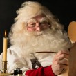Santa Claus sitting at home and writing to do list — Stock Photo