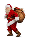 Santa Claus on the run to delivery christmas gifts — Stock Photo