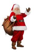 Real Santa Claus carrying big bag — Stock Photo