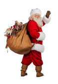 Real Santa Claus carrying big bag — Stock Photo