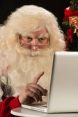 Santa Claus working on computer — Stock Photo