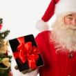 Santa Claus holding gift Tablet computer — Stock Photo