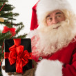Stock Photo: Santa Claus holding gift Tablet computer