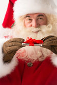 Santa Claus holding gift device in his hands — Stock Photo