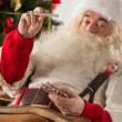 Astonished Santa Claus measuring his temperature — Stock Photo #35233701