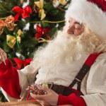 Santa Claus measuring his temperature — Stock Photo
