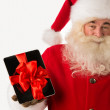 Santa Claus holding gift Tablet computer — Stock Photo #35234275