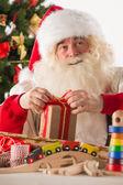 Santa Claus working — Stock Photo