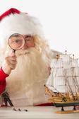 Santa Claus making toys — Stock Photo