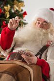 Astonished Santa Claus measuring his temperature — Stock Photo