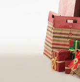 Boxes with presents wrapped in red paper — Stock Photo