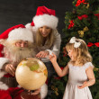 Santa Claus sitting at home with family — Stock Photo #36110175