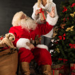 Photo of Santa Claus with his wife — Stock Photo