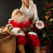 Happy Santa Claus with his wife at home. — Stock Photo